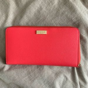Kate Spade large coral zippered wallet. Like new.